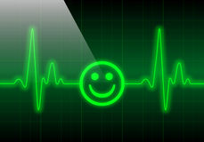 Smiley face on green heart rate monitor Royalty Free Stock Photos