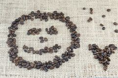 Smiley face and heart shape  made entirely out of coffee grains Stock Photo
