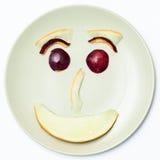 Smiley Face, hecho con las nectarinas y el melón Fotos de archivo libres de regalías