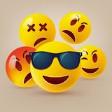 Smiley face icons or yellow emoticons with emotional funny faces in glossy 3D realistic stock photos