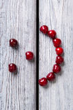 Smiley face made of cherries. Stock Photography