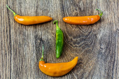 Smiley face made of chili pepper Stock Photography
