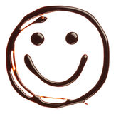 Smiley face made of chocolate syrup Stock Photos