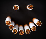 Smiley face made of cigarettes Stock Photo