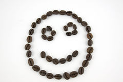 Smiley face made of coffee beans Royalty Free Stock Photography
