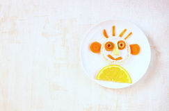 Smiley face made of fruits and vegetable. Pic stock image