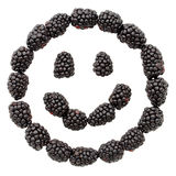 Smiley face made out of blackberries Stock Photo