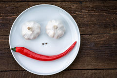 Smiley face made from pepper, garlic and flavoring Stock Photos