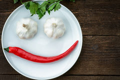 Smiley face made from pepper, garlic and parsley Royalty Free Stock Photo