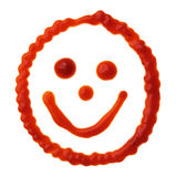 Smiley face made of tomato sauce Stock Image