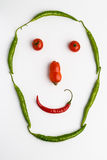 Smiley face made of tomatoes and chilli peppers Royalty Free Stock Photography