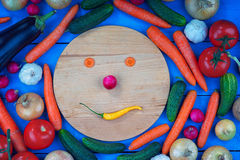 Smiley face made from vegetables among colorful vegetables Stock Images