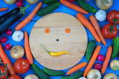 Smiley face made from vegetables among fresh vegetables Royalty Free Stock Image