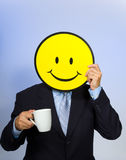 Smiley Face Man. Drinking a cup of coffee royalty free stock image