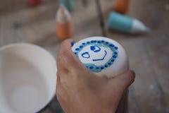 Smiley face on mug Royalty Free Stock Photos