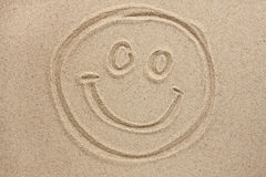 Smiley face painted by in the sand Stock Photography