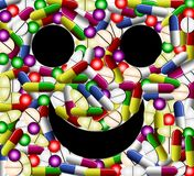 Smiley face with pills Royalty Free Stock Photography