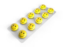 Smiley face pills in blister. On white background Royalty Free Stock Photo