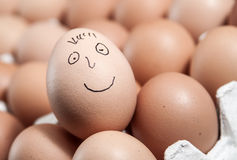 Smiley Face on a raw Egg Stock Photography