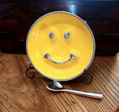 Smiley face. Round yellow plate with a smile Royalty Free Stock Photos