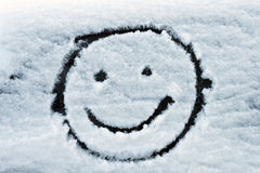 Smiley face on snow. Smiley face drawn on snow royalty free stock photography