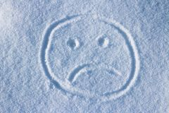Smiley face in the snow. Smiley face drawn in the snow on a sunny day royalty free stock photos