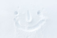 Smiley face in the snow Royalty Free Stock Images