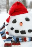 Smiley face snowman. With a red hat Royalty Free Stock Photos