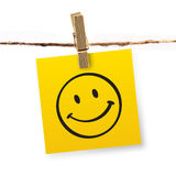 Smiley face symbol. Note hanging on the rope royalty free stock photos