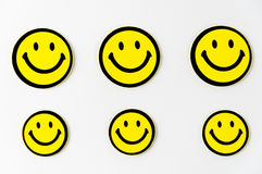 Smiley face symbol. Note hanging on the rope Stock Photo