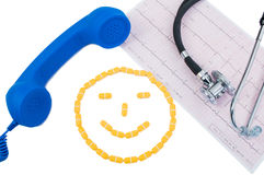 Smiley face, telephone and ekg Royalty Free Stock Photo