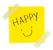 Smiley Face yellow sticky note. With masking tape on white background Stock Images