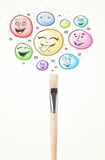 Smiley faces coming out of paintbrush Royalty Free Stock Image