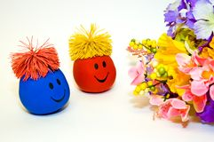 Smiley Faces and Flower Bouquet. Two smiley faces look happily at a fresh bouquet of flowers that have just been delivered.  Possible theme:  Receiving flowers Stock Photography