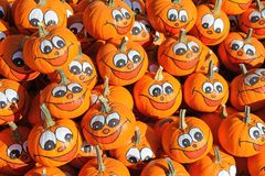 Smiley faces painted on fresh Pumpkins Stock Photos