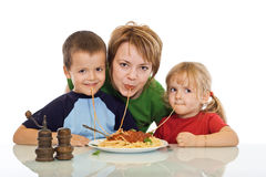 Smiley family eating pasta Stock Photo