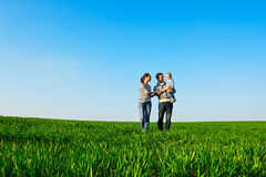 Smiley family walking at the field Royalty Free Stock Photography