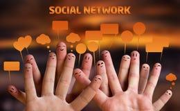 smiley felizes do dedo com bolhas do discurso Imagem de Stock