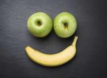 Smiley with fresh fruits on slate stone. Stock Photo
