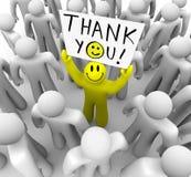 Smiley-Gesichts-Personen-Holding danken Ihnen zu kennzeichnen Stockfotos