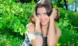Smiley girl. In the garden Stock Image