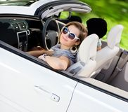 Smiley girl in the car with her friend Stock Photos