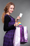 Smiley girl with credit card and paper bags Royalty Free Stock Images