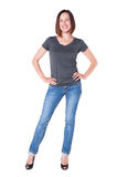 Smiley girl in grey t-shirt and blue jeans Royalty Free Stock Photography