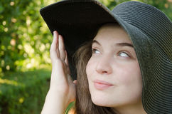 Smiley girl with. Girl with hat in park on summer day Royalty Free Stock Photo