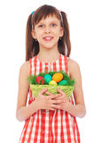 Smiley girl holding basket with colorful eggs. Pretty smiley girl holding basket with colorful eggs Royalty Free Stock Image