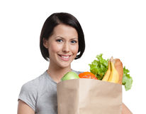 Smiley girl keeps the packet of vegetables Stock Photos