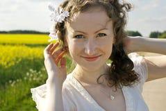 Smiley girl portrait. Portrait of nice curly girl Stock Photos