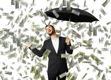 Smiley glad businessman with umbrella Stock Images