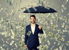 Smiley and glad man under money rain Royalty Free Stock Photos
